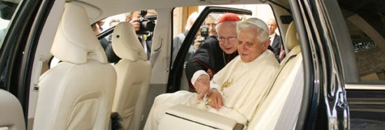 Pope Benedict.  In a car.  A very nice car.  Who says Popes should live piously with few of life's luxuries?